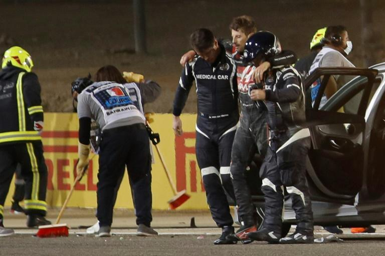 Romain Grosjean was helped from the site of his accident before being transferred to hospital