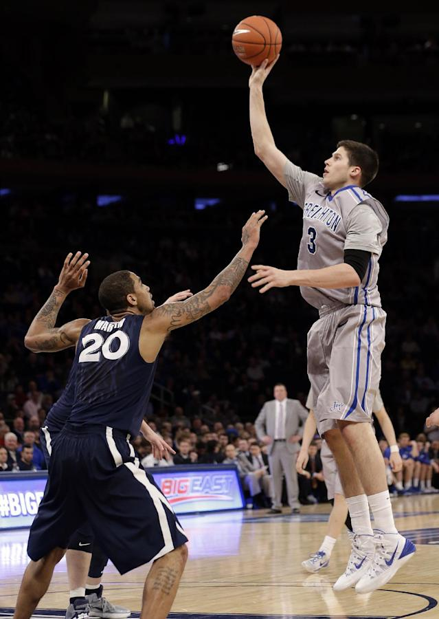 Creighton's Doug McDermott (3) shoots over Xavier's Justin Martin (20) during the first half of an NCAA college basketball game in the semifinals of the Big East Conference men's tournament Friday, March 14, 2014, at Madison Square Garden in New York. (AP Photo/Frank Franklin II)