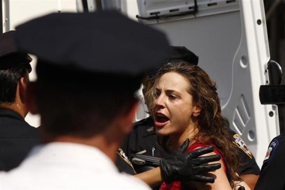New York Police Department officers arrest a woman demonstrating in solidarity with the Russian punk band Pussy Riot in front of the Russian Consulate, in New York August 17, 2012.