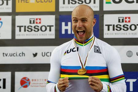 Cycling - UCI Track World Championships - Men's Sprint, Final - Hong Kong, China – 15/4/17 - Russia's Denis Dmitriev poses with gold medal. REUTERS/Bobby Yip