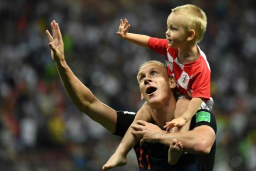 Croatia defender Domagoj Vida celebrates with his son after victory against England in the World Cup semi-finals