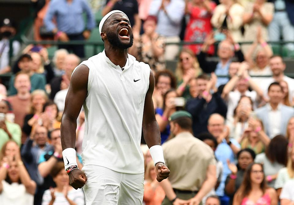 TOPSHOT - US player Frances Tiafoe celebrates his win over Greece's Stefanos Tsitsipas during their men's singles first round match on the first day of the 2021 Wimbledon Championships at The All England Tennis Club in Wimbledon, southwest London, on June 28, 2021. - - RESTRICTED TO EDITORIAL USE (Photo by Ben STANSALL / AFP) / RESTRICTED TO EDITORIAL USE (Photo by BEN STANSALL/AFP via Getty Images)