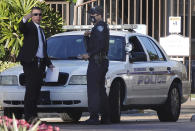 Law enforcement personnel continue to work at an apartment complex the day after a deadly shooting in Sunrise, Fla., Wednesday, Feb. 3, 2021. Several FBI agents were killed and others wounded while trying to serve a search warrant on a child pornography suspect in Florida. FBI authorities say the suspect also died. (Joe Cavaretta/South Florida Sun-Sentinel via AP)