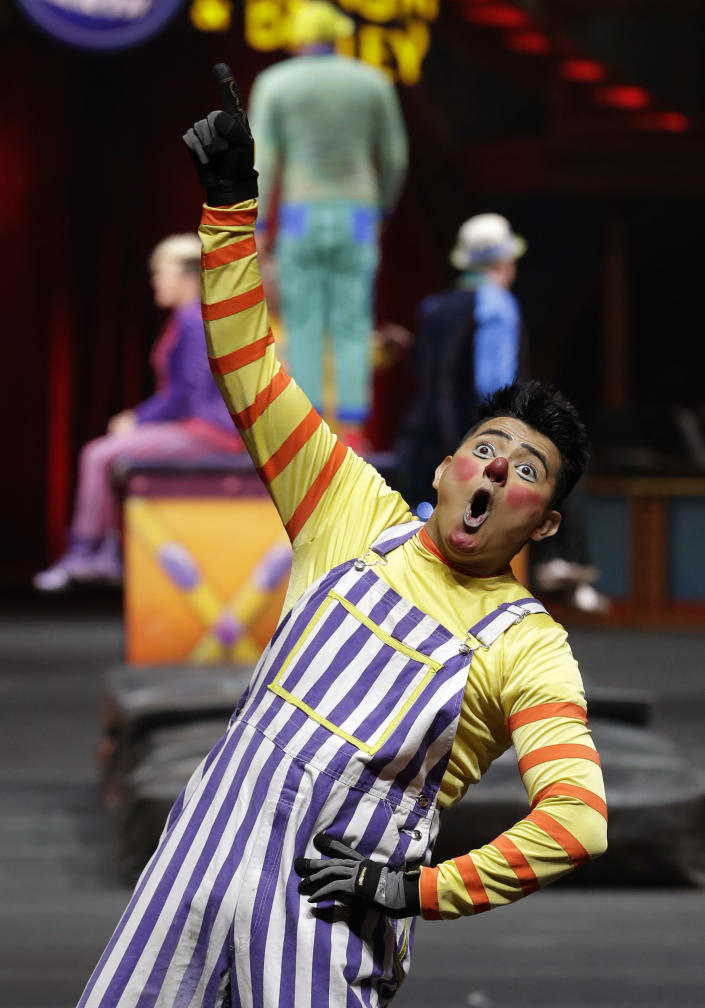 """A Ringling Bros. and Barnum & Bailey clown performs Saturday, Jan. 14, 2017, in Orlando, Fla. The Ringling Bros. and Barnum & Bailey Circus will end the """"The Greatest Show on Earth"""" in May, following a 146-year run of performances. Kenneth Feld, the chairman and CEO of Feld Entertainment, which owns the circus, told The Associated Press, declining attendance combined with high operating costs are among the reasons for closing. (AP Photo/Chris O'Meara)"""
