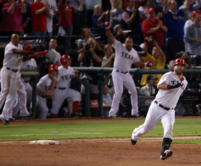 ARLINGTON, TX - OCTOBER 24: Mike Napoli #25 of the Texas Rangers rounds first base after hitting a two-run double in the eighth inning during Game Five of the MLB World Series against the St. Louis Cardinals at Rangers Ballpark in Arlington on October 24, 2011 in Arlington, Texas. (Photo by Doug Pensinger/Getty Images)