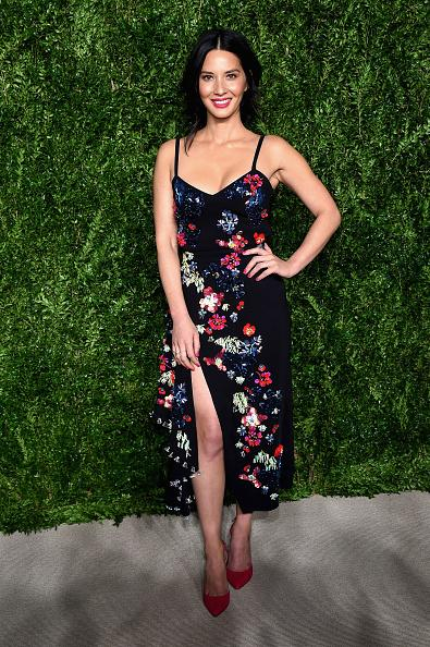 <p>The actress wore a black frock with a dangerously high slit and unique, multicolored floral detailing. She attended the event to support Chloe Gosselin, one of the 2016 CFDA Vogue Fashion Fund finalists. (Photo: Getty Images) </p>