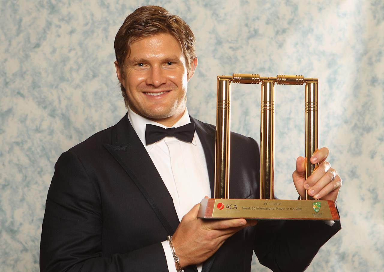 MELBOURNE, AUSTRALIA - FEBRUARY 27: Shane Watson poses with the Twenty 20 International Player of the Year trophy during the 2012 Allan Border Medal Awards at Crown Palladium on February 27, 2012 in Melbourne, Australia.  (Photo by Lucas Dawson/Getty Images)