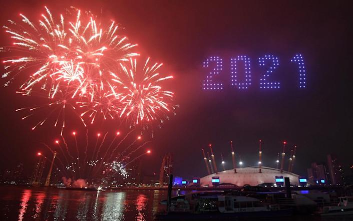 Fireworks and drones illuminate the night sky over the The O2 in London