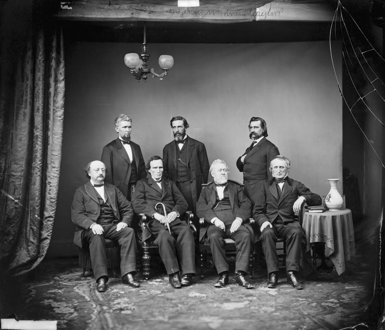 Mathew Brady studio portrait of the House of Representatives impeachment committee of President Andrew Johnson in 1868. Standing from left are James F. Wilson, George S. Boutwell and John A. Logan. Seated are Benjamin F. Butler, Thaddeus Stevens, Thomas Williams and John A. Bingham.