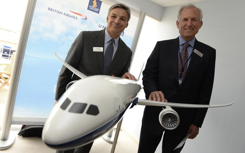 Boeing company's chairman and CEO, McNerney and Conner, President and CEO of Boeing commercial airplanes, pose with a 787-10 model during the 50th Paris Air Show, at the Le Bourget airport