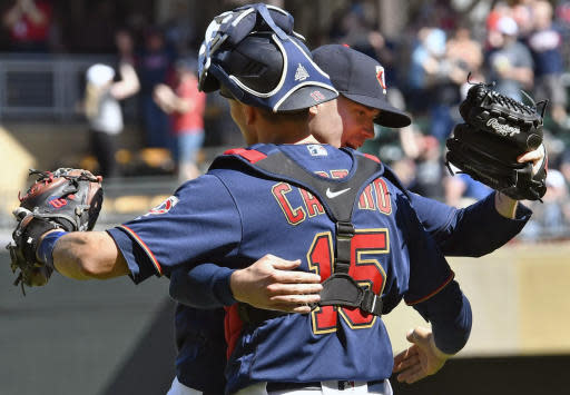 Minnesota Twins pitcher Mike Morin, right, and catcher Jason Castro celebrate the Twins' 8-7 win over the Los Angeles Angels in Wednesday, May 15, 2019, in Minneapolis. Morin pricked up the save. (AP Photo/Jim Mone)