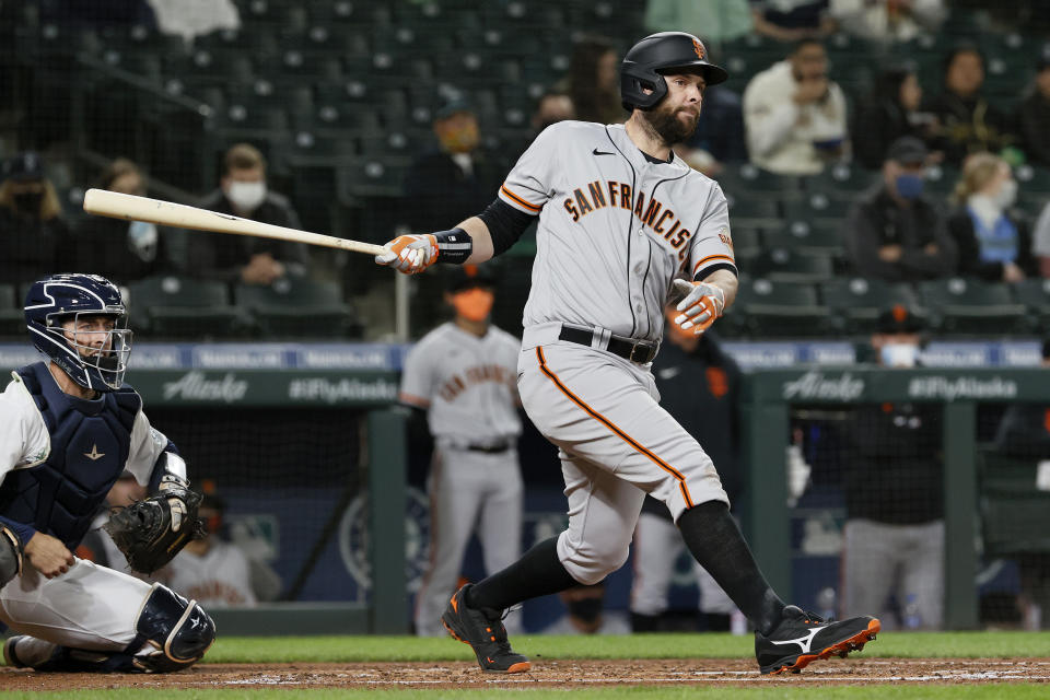 SEATTLE, WASHINGTON - APRIL 01: Brandon Belt #9 of the San Francisco Giants at bat against the Seattle Mariners in the fourth inning on Opening Day at T-Mobile Park on April 01, 2021 in Seattle, Washington. (Photo by Steph Chambers/Getty Images)