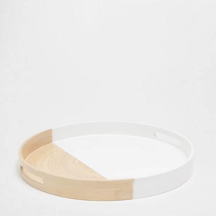This bamboo tray is as much a decor accent piece as it is utilitarian. When youre not using it for food, place it on your coffee table to house your favorite books or fresh flowers.Large Bamboo Tray, $49.90