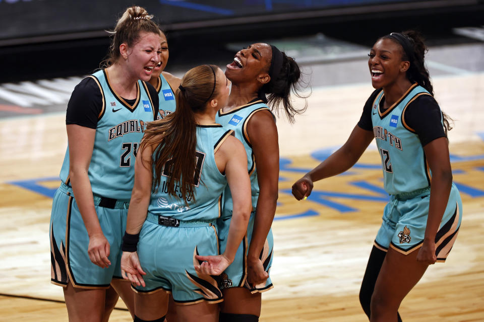 New York Liberty guard Sabrina Ionescu (20) reacts after making the game winning basket against the Indiana Fever during a WNBA basketball game, Friday, May 14, 2021, in New York. (AP Photo/Adam Hunger)