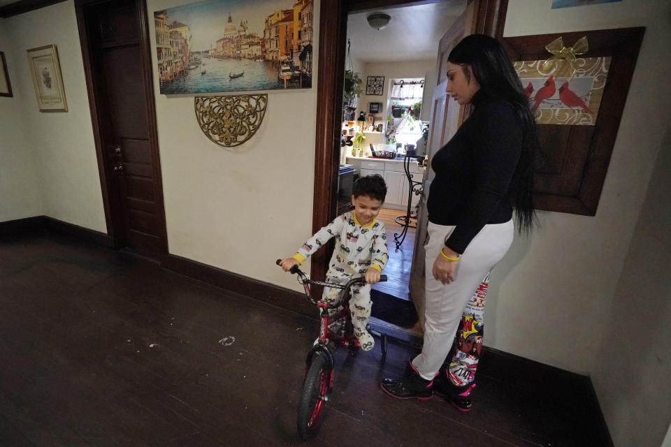 Isabel Miranda's 4-year-old son, Julian, rides his bike into the hallway, Wednesday, March 10, 2021, of their rental apartment in Haverhill, Mass. The Biden administration is extending a federal moratorium on evictions of tenants who've fallen behind on rent during the coronavirus pandemic. Miranda, who has an eviction hearing next month from the apartment, said she had mixed feelings about the extension. She worries that the courts and the landlord will not recognize the federal moratorium but also recognizes it gives her time to come up with the nearly $10,000 in back rent. (AP Photo/Elise Amendola)