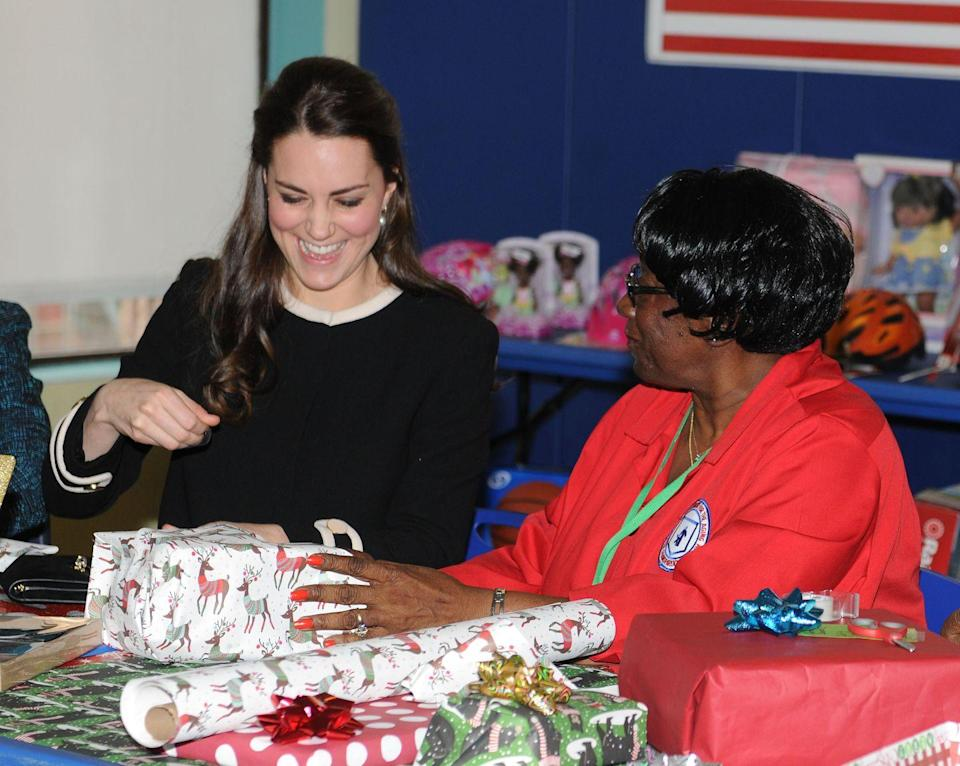<p>The Duchess of Cambridge helps wrap Christmas presents at the Northside Centre for Child Development in New York City.</p>