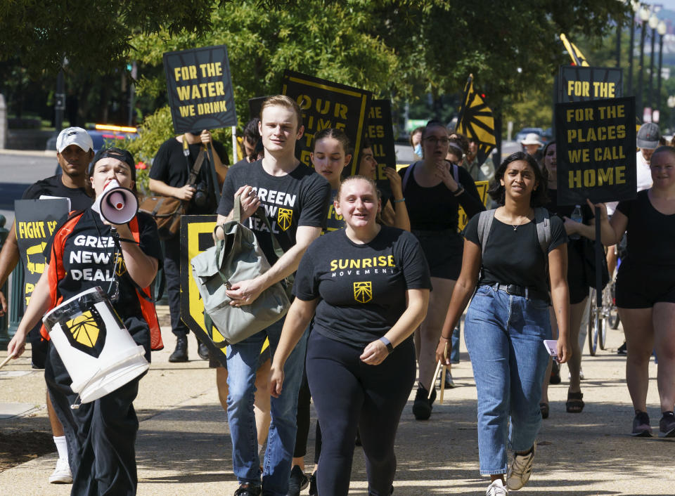 Climate change activists demonstrate outside the Hart Senate Office Building on Capitol Hill in Washington, Monday, Sept. 20, 2021. (AP Photo/J. Scott Applewhite)