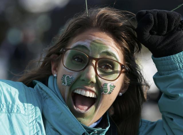 Saskatchewan Roughriders fan Lianne MacLean stands outside the stadium before the CFL's 101st Grey Cup championship football game in Regina, Saskatchewan November 24, 2013. REUTERS/Todd Korol (CANADA - Tags: SPORT FOOTBALL)