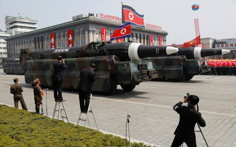 Missiles are driven past the stand during a military parade marking the 105th birth anniversary of country's founding father in Pyongyang - REUTERS