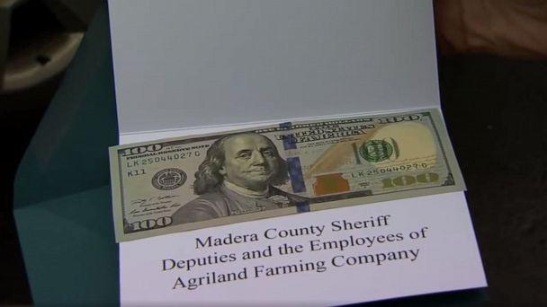 PHOTO: Instead of issuing traffic tickets, deputies with the Madera County Sheriff's Department in Central California gave motorists holiday cards containing $100 as part of a holiday outreach program, Dec. 23, 2019. (KFSN)