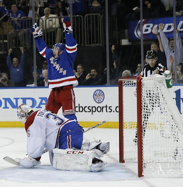 New York Rangers center Brian Boyle (22) reacts as the puck crosses the goal line against Montreal Canadiens goalie Dustin Tokarski (35) during the second period in Game 6 of the NHL hockey Stanley Cup playoffs Eastern Conference finals, Thursday, May 29, 2014, in New York. The Rangers won 1-0