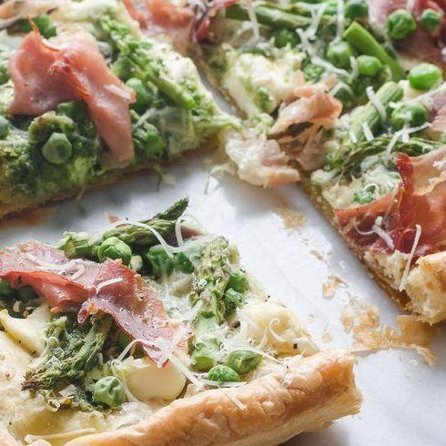 "<p>This airy, flaky puff pastry tart is topped with vibrant pesto and crispy prosciutto. Mom will love it.</p><p><strong><a href=""https://www.thepioneerwoman.com/food-cooking/recipes/a101104/spring-puff-pastry-tart/"" rel=""nofollow noopener"" target=""_blank"" data-ylk=""slk:Get the recipe"" class=""link rapid-noclick-resp"">Get the recipe</a>.</strong></p><p><a class=""link rapid-noclick-resp"" href=""https://go.redirectingat.com?id=74968X1596630&url=https%3A%2F%2Fwww.walmart.com%2Fsearch%2F%3Fquery%3Dbaking%2Bsheets&sref=https%3A%2F%2Fwww.thepioneerwoman.com%2Ffood-cooking%2Fmeals-menus%2Fg35589850%2Fmothers-day-dinner-ideas%2F"" rel=""nofollow noopener"" target=""_blank"" data-ylk=""slk:SHOP BAKING SHEETS""><strong>SHOP BAKING SHEETS</strong></a></p>"