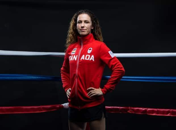 Tokyo-bound Canadian boxer Mandy Bujold takes part in a photoshoot at the SydFIT Health Centre in Kitchener, Ont., on Tuesday. (Michael P. Hall/COC - image credit)