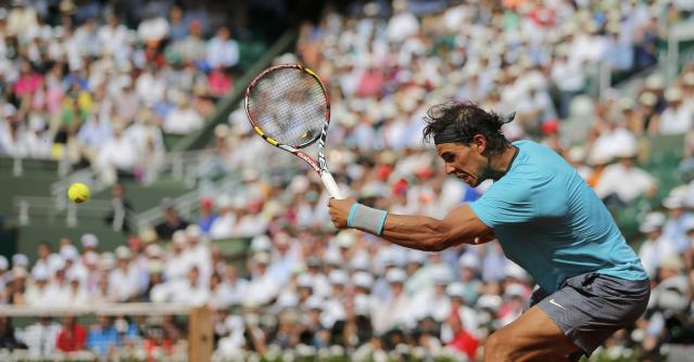 Rafael Nadal of Spain returns the ball to Novak Djokovic of Serbia during their men's singles final match at the French Open Tennis tournament at the Roland Garros stadium in Paris