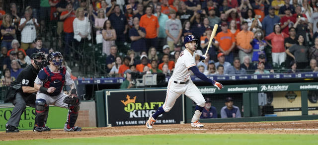Houston Astros' Carlos Correa, right, hits a game-winning RBI single as Boston Red Sox catcher Christian Vazquez watches during the ninth inning of a baseball game Saturday, May 25, 2019, in Houston. The Astros won 4-3. (AP Photo/David J. Phillip)