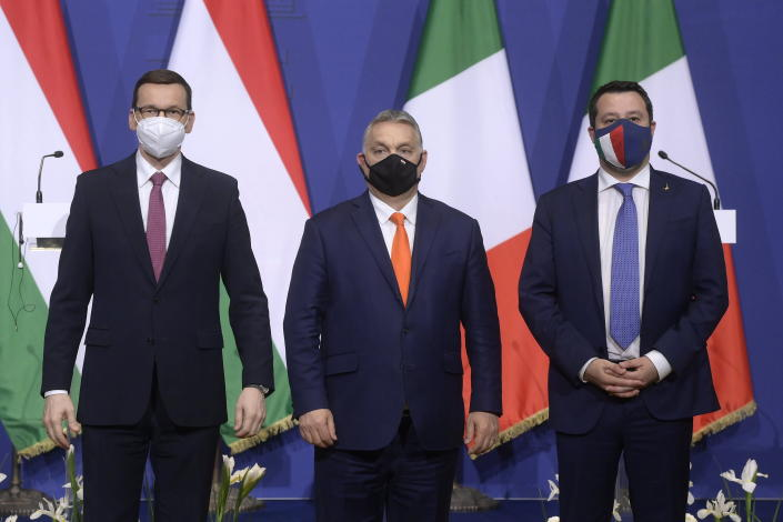 From left, Polish Prime Minister Mateusz Morawiecki, Hungarian Prime Minister Viktor Orban and Leader of Italian right-wing ruling party Lega, Matteo Salvini, attend a joint press conference after their trilateral meeting focused on creating a European-level alliance between Hungary's ruling Fidesz, Italy's Lega and Poland's PiS party at the PM's office in the Castle of Buda, in Budapest, Hungary, Thursday, April 1, 2021. (Szilard Koszticsak/MTI via AP)