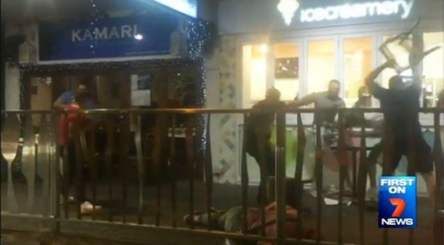 The melee saw men throwing punches and chairs in front of scared onlookers. Photo: 7 News