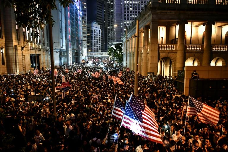 Hong Kong pro-democracy protesters rally in suport of the Human Rights and Democracy Act, a US bill that could dramatically alter Washington's relationship with the semi-autonomous trading hub (AFP Photo/Anthony WALLACE)