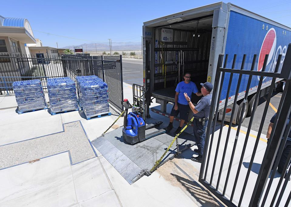 TRONA, CA - JULY 06: Pepsi employee J.B. Lloyd speaks with a San Bernardino County firefighter at Trona High School after delivering 6 pallets of water to the town Saturday July 6, 2019. The area has been hit with two major earthquakes since Thursday. (Photo by Will Lester/MediaNews Group/Inland Valley Daily Bulletin via Getty Images)