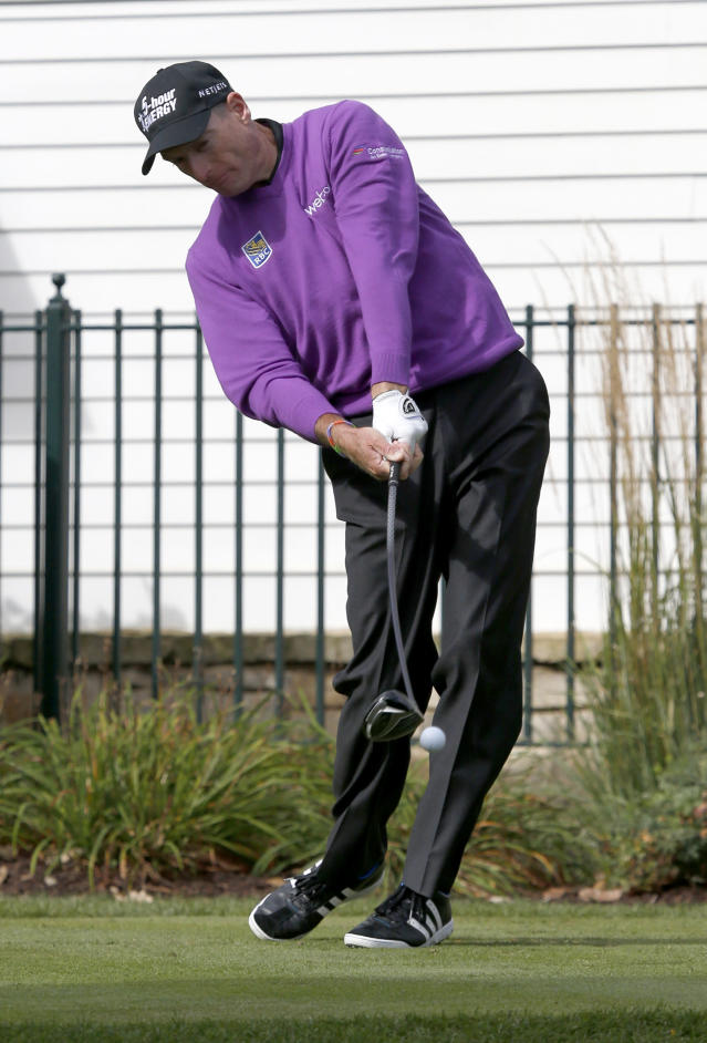 Jim Furyk strikes his tee shot at the third hole during the final round of the BMW Championship golf tournament at Conway Farms Golf Club in Lake Forest, Ill., Monday, Sept. 16, 2013. (AP Photo/Charles Rex Arbogast)