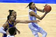 Kentucky's B.J. Boston, right, shoots in front of Morehead State players during the second half of an NCAA college basketball game in Lexington, Ky., Wednesday, Nov. 25, 2020. Kentucky won 81-45. (AP Photo/James Crisp)