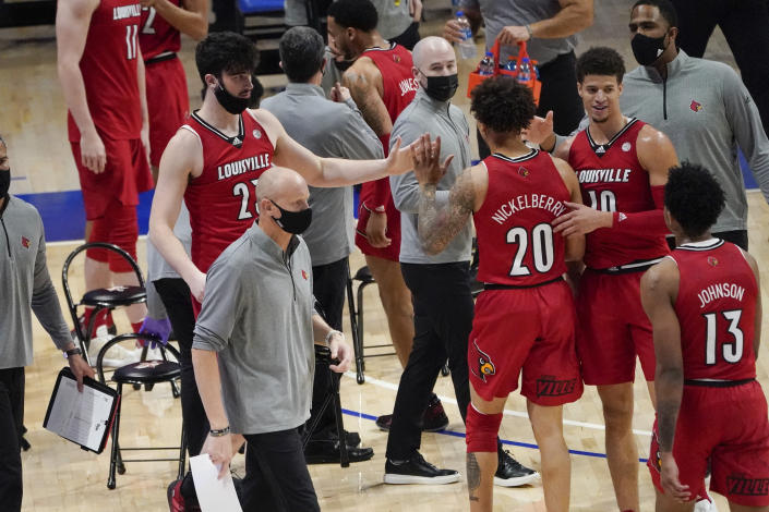 Louisville head coach Chris Mack works curtsied as his team plays against Pittsburgh during an NCAA college basketball game, Tuesday, Dec. 22, 2020, in Pittsburgh. (AP Photo/Keith Srakocic)
