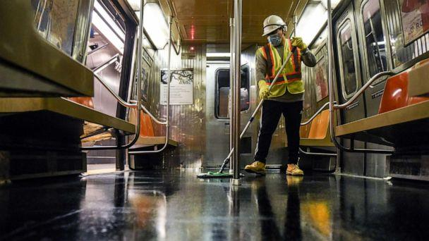 PHOTO: A cleaning crew disinfects a New York City subway train on May 4, 2020 in New York City. (Stephanie Keith/Getty Images)