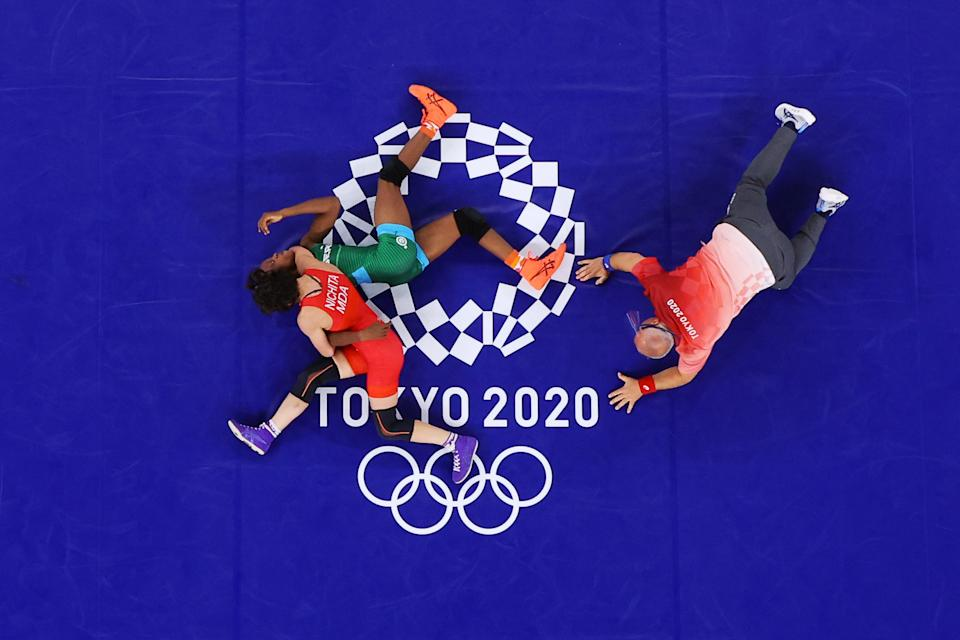 <p>Anastasia Nichita of Team Moldova competes against Odunayo Folasade Adekuoroye of Team Nigeria during the Women's Freestyle 57kg 1/8 Final on day twelve of the Tokyo 2020 Olympic Games at Makuhari Messe Hall on August 04, 2021 in Chiba, Japan. (Photo by Maddie Meyer/Getty Images)</p>