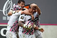 Stade Francais Paris' Samoan prop Sakaria Taulafo (C) celebrates with teammates after scoring a try during their French Top 14 rugby match against Clermont, at Jean Bouin stadium in Paris, on March 28, 2015 (AFP Photo/Martin Bureau)