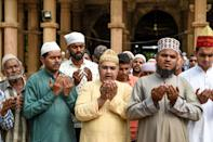 Muslims participate in a special prayer asking to maintain peace and harmony across India ahead of the court verdict of disputed religious site of Ayodhya, in the campus of ancient holy shrine of Hazrat Saiyed Usman Shamme Burhani in Ahmedabad on November 8, 2019. - Indian police have arrested more than 500 people ahead of a Supreme Court ruling on a hotly disputed religious site in the holy city of Ayodhya, media reports said, with authorities fearing the verdict could trigger unrest. (Photo by SAM PANTHAKY / AFP) (Photo by SAM PANTHAKY/AFP via Getty Images)