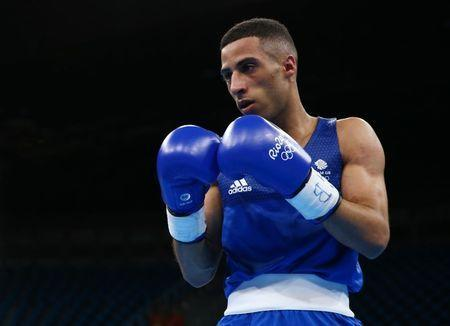2016 Rio Olympics - Boxing - Preliminary - Men's Light Fly (49kg) Round of 32 Bout 39 - Riocentro - Pavilion 6 - Rio de Janeiro, Brazil - 08/08/2016. Galal Yafai (GBR) of United Kingdom competes. REUTERS/Peter Cziborra