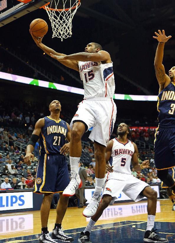 Atlanta Hawks power forward Al Horford (15) shoots past Indiana Pacers power forward David West (21) during the first half of a preseason NBA basketball game on Tuesday, Oct. 22, 2013, in Atlanta. (AP Photo/Atlanta Journal-Constitution, Curtis Compton)