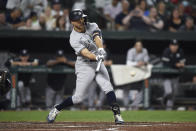 New York Yankees' Giancarlo Stanton hits a single against the Baltimore Orioles during the fifth inning of a baseball game Thursday, Sept. 16, 2021, in Baltimore. (AP Photo/Gail Burton)