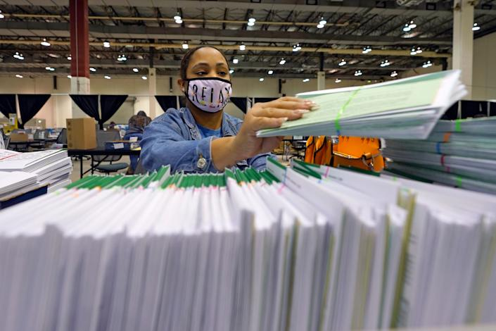 Harris County election worker Romanique Tillman prepares mail-in ballots to be sent out to voters Tuesday, Sept. 29, 2020, in Houston.