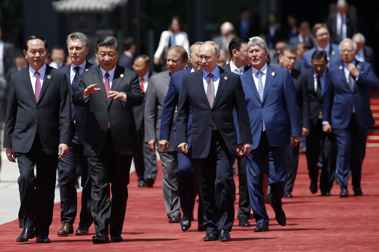 Chinese President Xi Jinping walks with Russian President Vladimir Putin and other leaders at the Belt and Road Forum outside Beijing in May 2017. (Photo: Damir Sagolj/Pool Photo via AP)