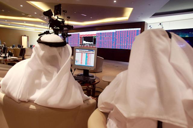 <p>Traders monitor screens displaying stock information at Qatar Stock Exchange in Doha, Qatar June 5, 2017. (Photo: Stringer/Reuters) </p>