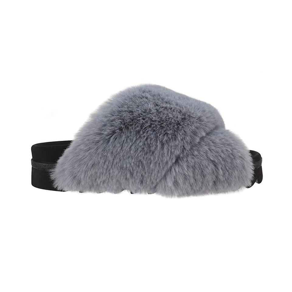 """<p><strong>Roam Wears</strong></p><p>roamwears.com</p><p><strong>$130.00</strong></p><p><a href=""""https://www.roamwears.com/collections/womens-slippers/products/icy-blue-cloud"""" rel=""""nofollow noopener"""" target=""""_blank"""" data-ylk=""""slk:Shop Now"""" class=""""link rapid-noclick-resp"""">Shop Now</a></p><p>I love the idea of super luxe faux fur slippers. Wearing them around the house adds a bit of glamour to Mom's day. They're available in an assortment of colors and faux shearling as well.</p>"""