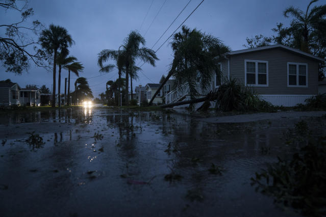 <p><strong>Bonita Springs</strong><br> Flood waters and storm damage are seen at Palm Lake RV Resort as Hurricane Irma works its way up the west Florida coast in Bonita Springs, Fla. on Sept 10, 2017. (Photo: Jabin Botsford/The Washington Post via Getty Images) </p>