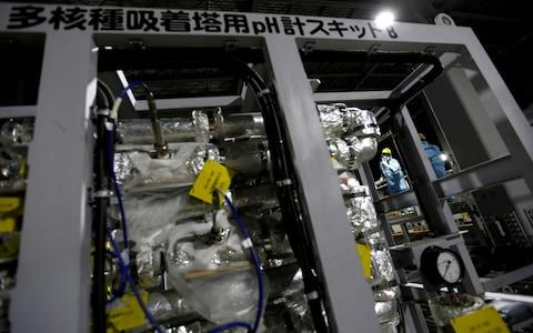 Tepco employees are seen inside the tsunami-crippled plant - Credit:  Issei Kato/ REUTERS