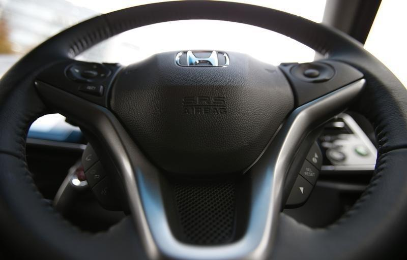 """An airbag logo is seen on a steering wheel of Honda Motor Co's all-new hybrid sedan """"Grace"""", which installed the airbag made by Takata Corp, during its unveiling event in Tokyo"""